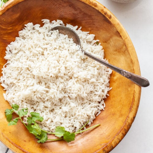Instant Pot Basmati Rice in a wooden bowl with a serving spoon