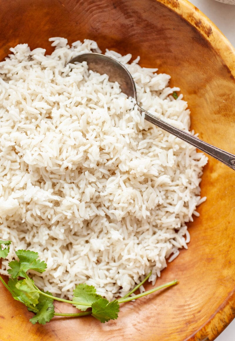 Close up of Instant Pot Basmati Rice in a wood bowl with serving spoon