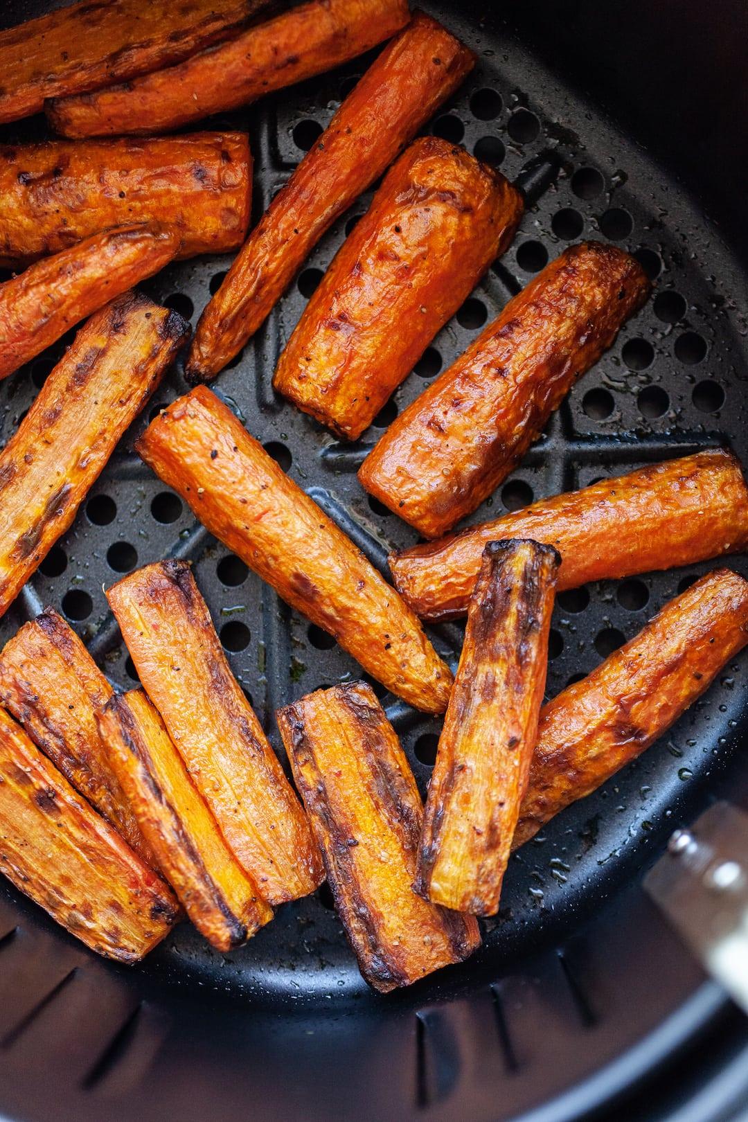 Incredible Air Fryer Carrots in an air fryer basket