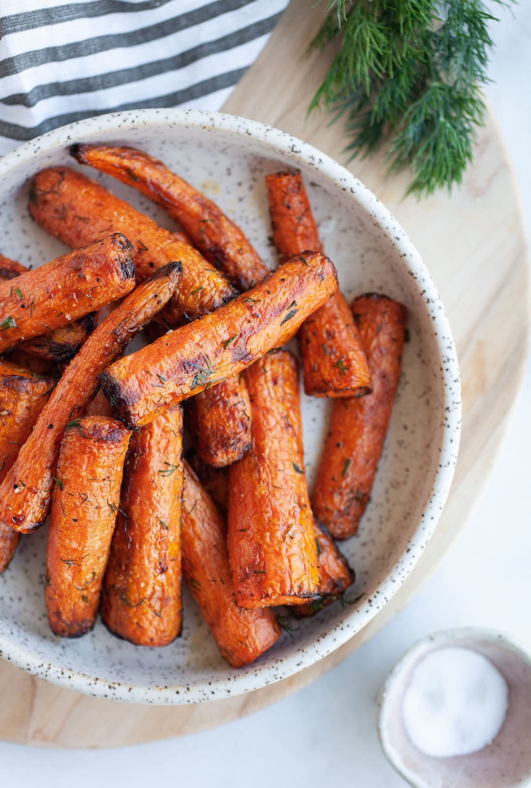 Incredible Air Fryer Carrots on a plate with fresh dill