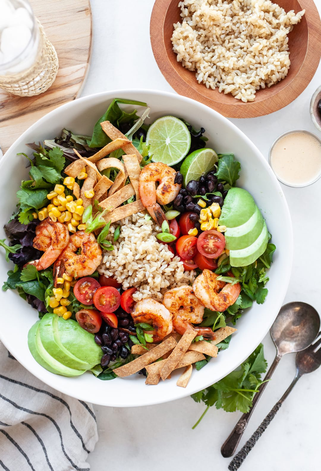 Healthy Southwest Salad in a bowl with rice, shrimp, avocado, beans and corn