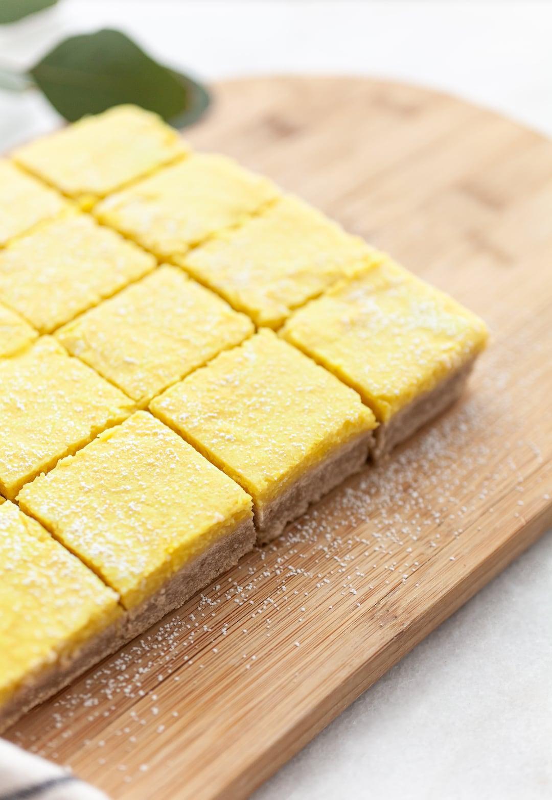 Side view of Best Vegan Lemon Bars cut into squares