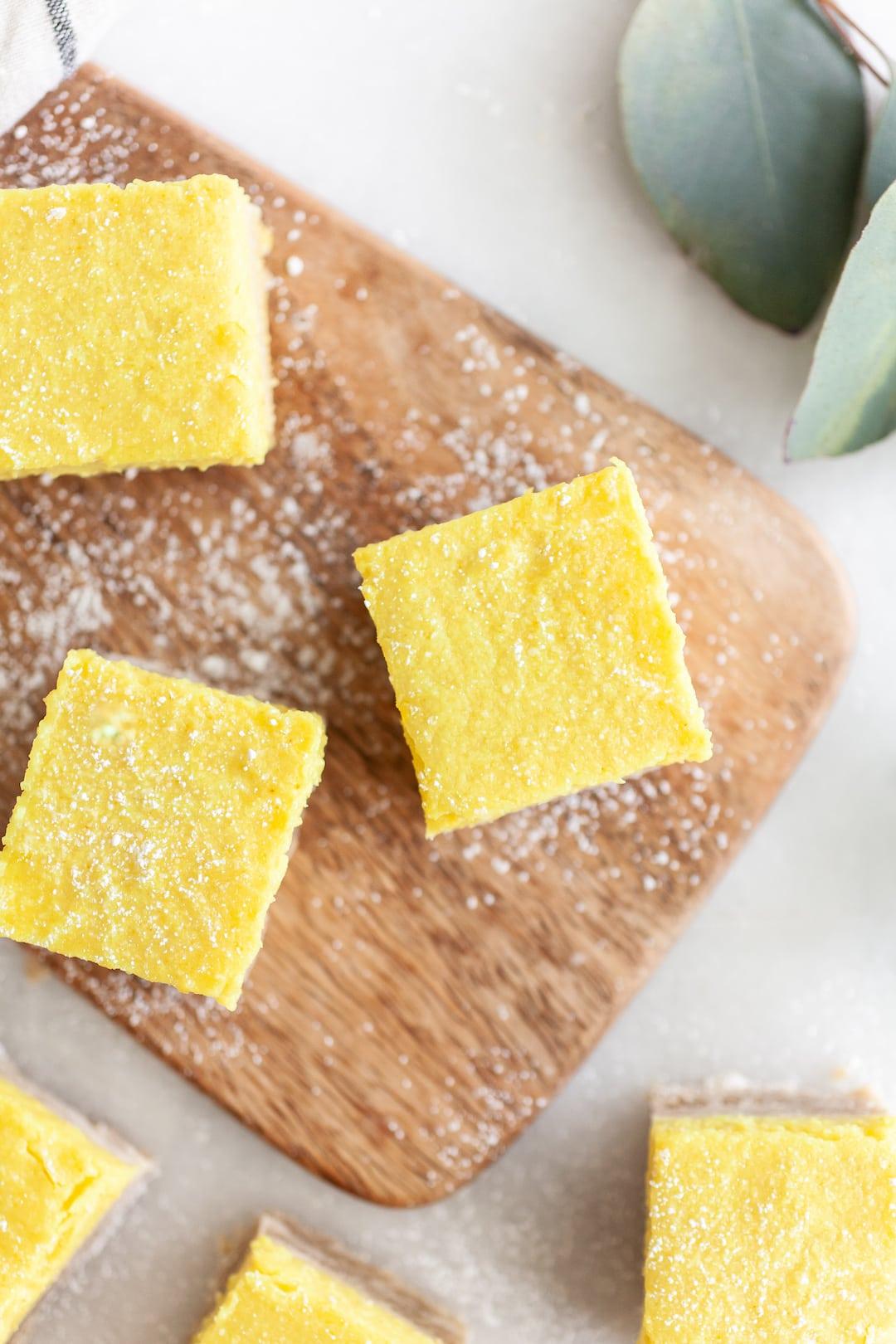 Overhead view of Best Vegan Lemon Bars on a wood platter