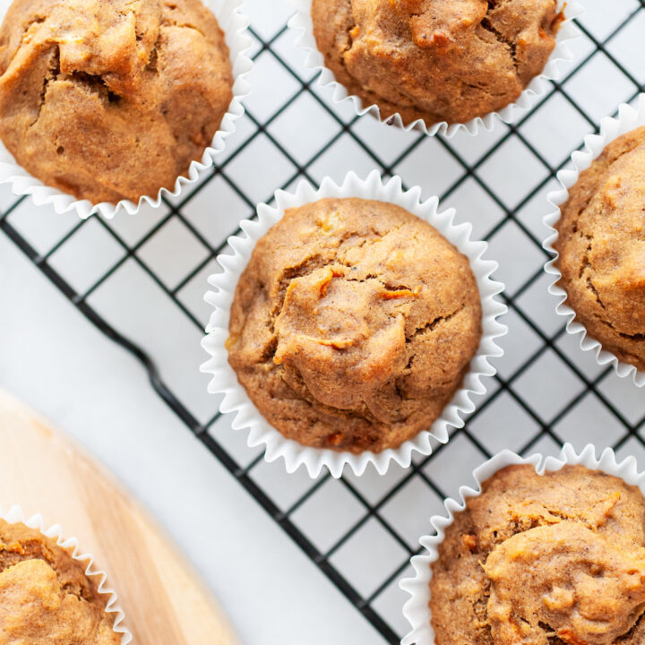 close up of banana carrot muffins on a cooling rack