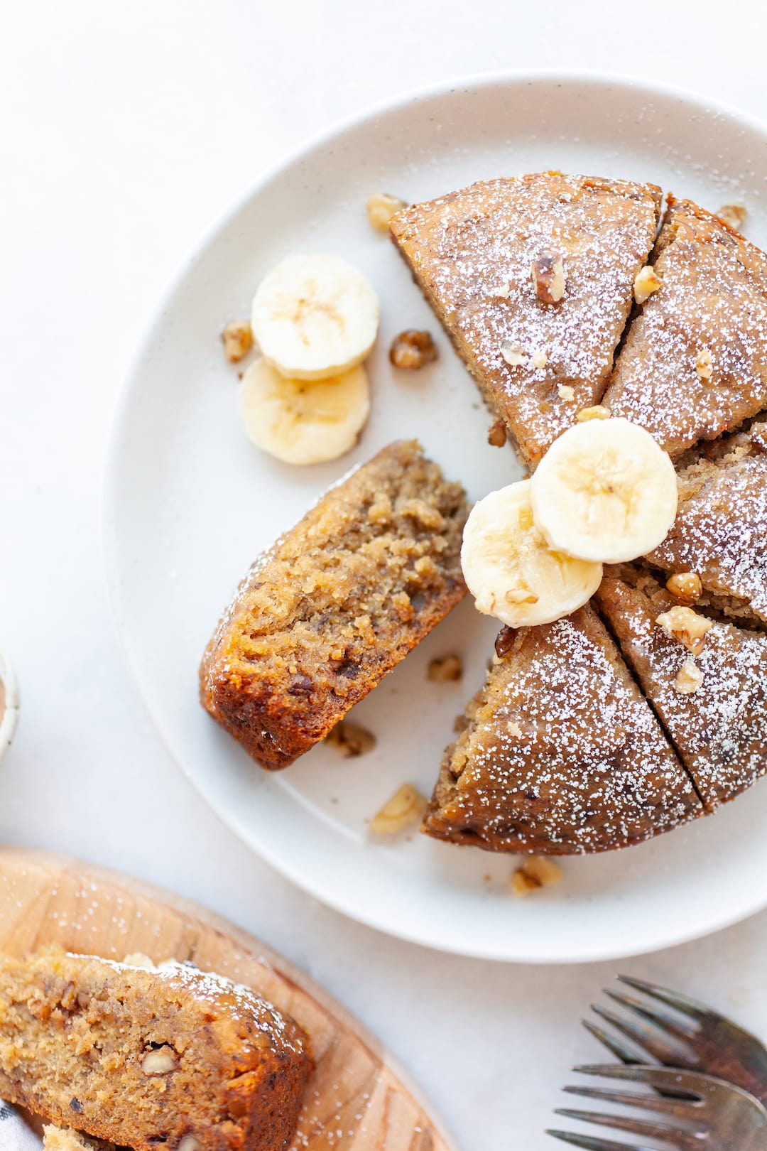 Close up of instant pot banana bread topped with powdered sugar and banana slices