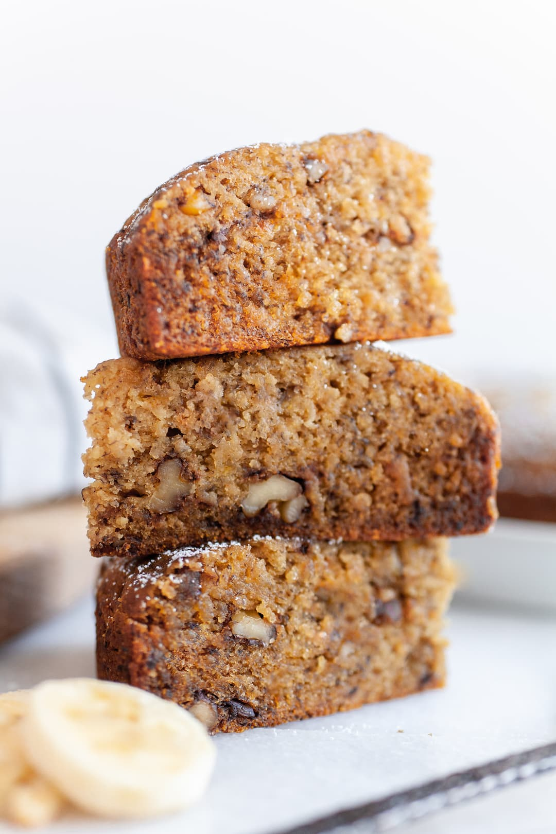 Close up of three slices of instant pot banana bread stacked
