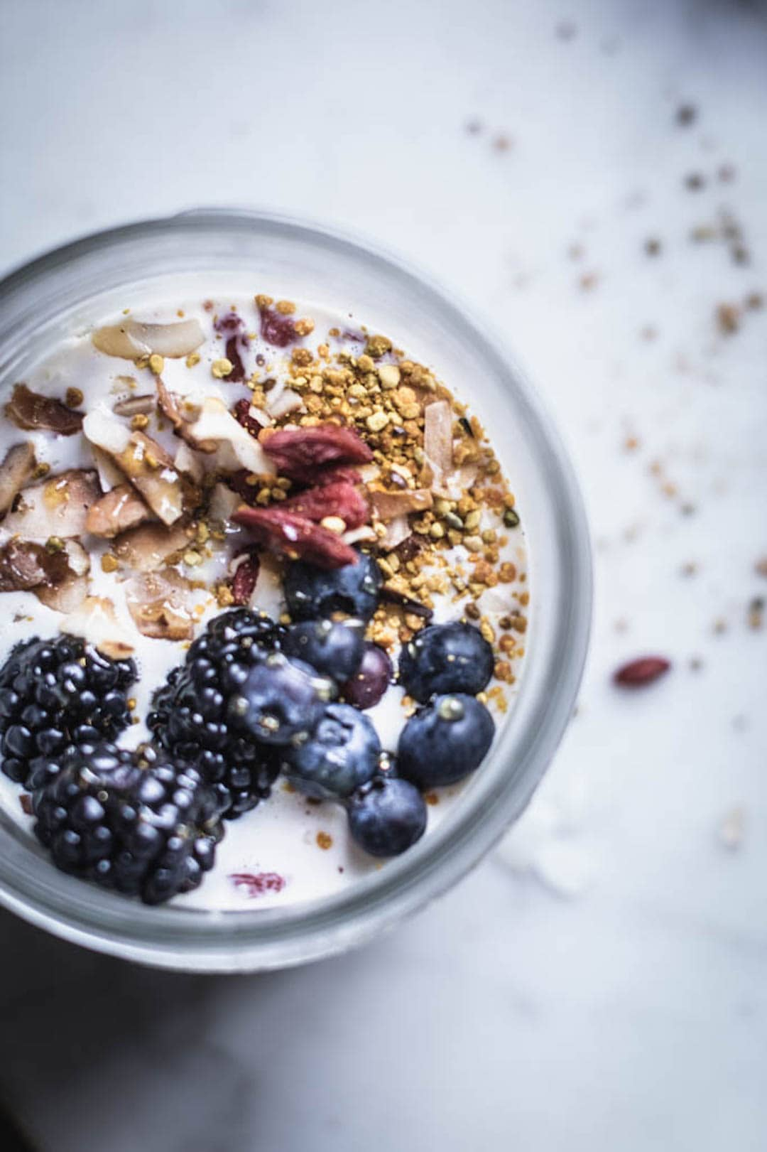Overnight oats topped with berries and bee pollen