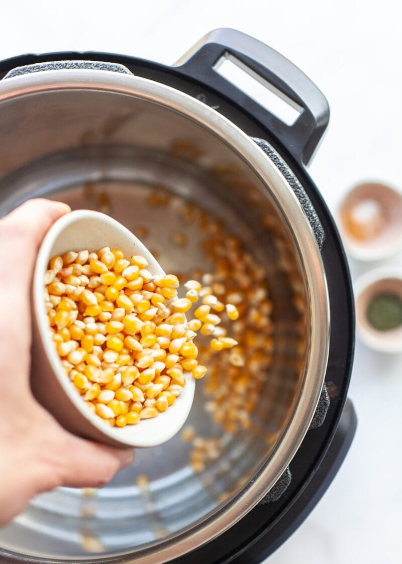 Pouring popcorn kernels into an instant pot