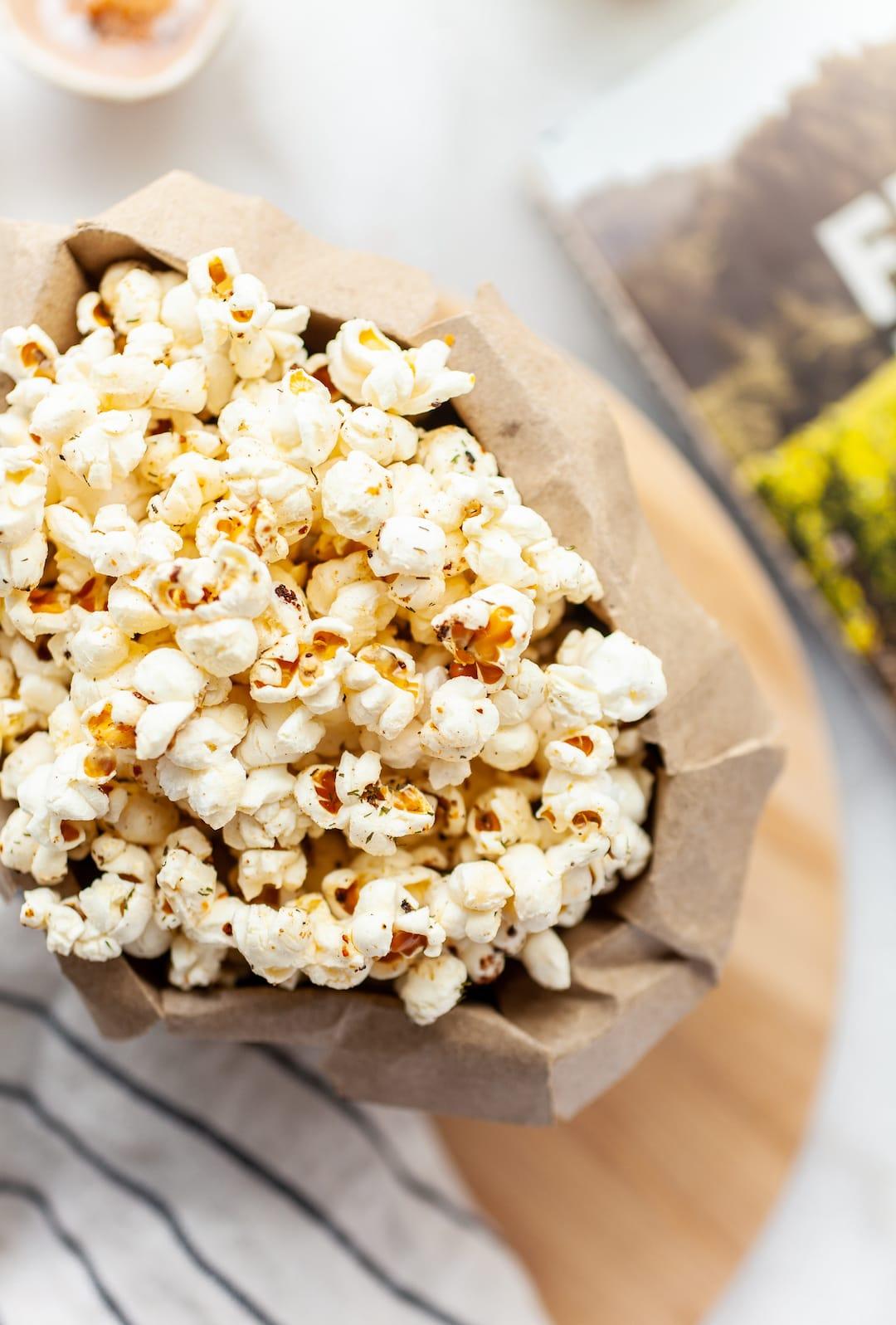 paper bag filled with instant pot popcorn