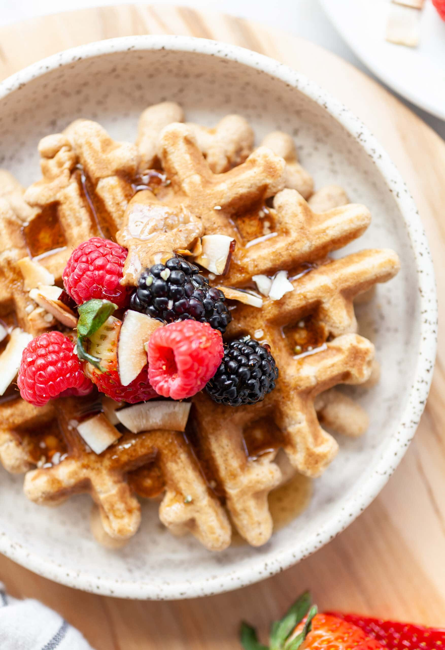 Close up of Easy Coconut Flour Waffles topped with fresh raspberries and blackberries
