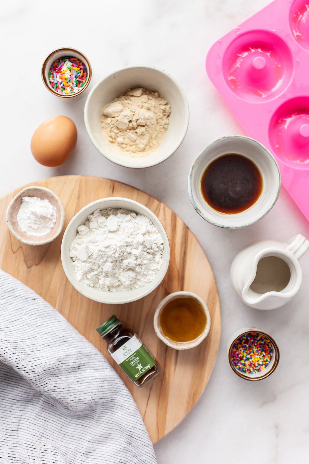 overhead view of flatly of ingredients for simple vanilla protein donuts