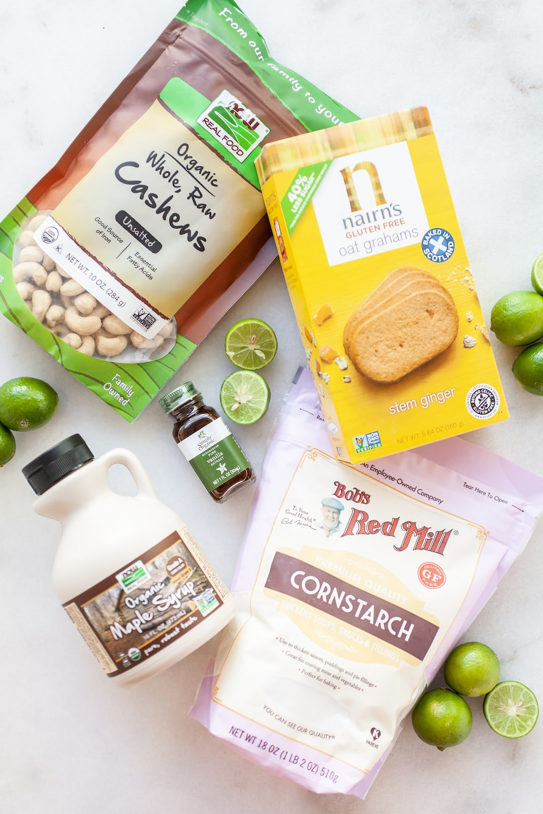 Ingredients for vegan key lime pie on a white marble board