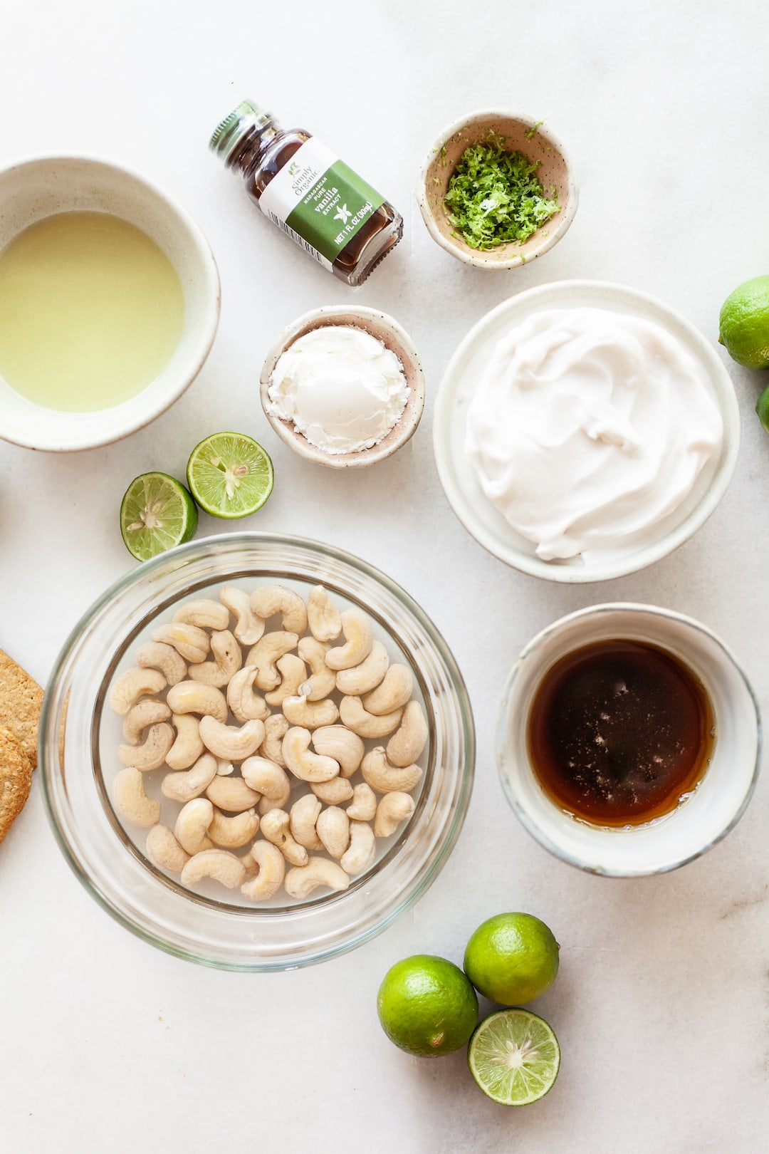 ingredients for vegan key lime pie filling on a marble board