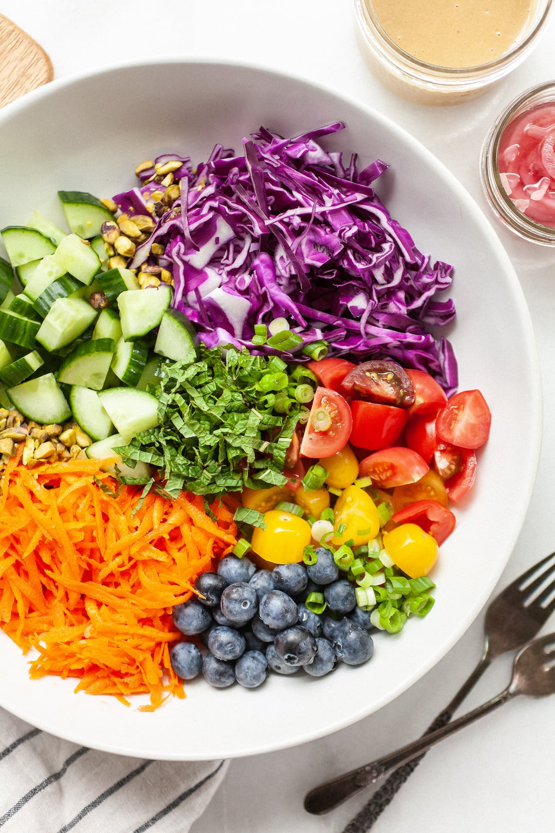 rainbow salad in a large white bowl
