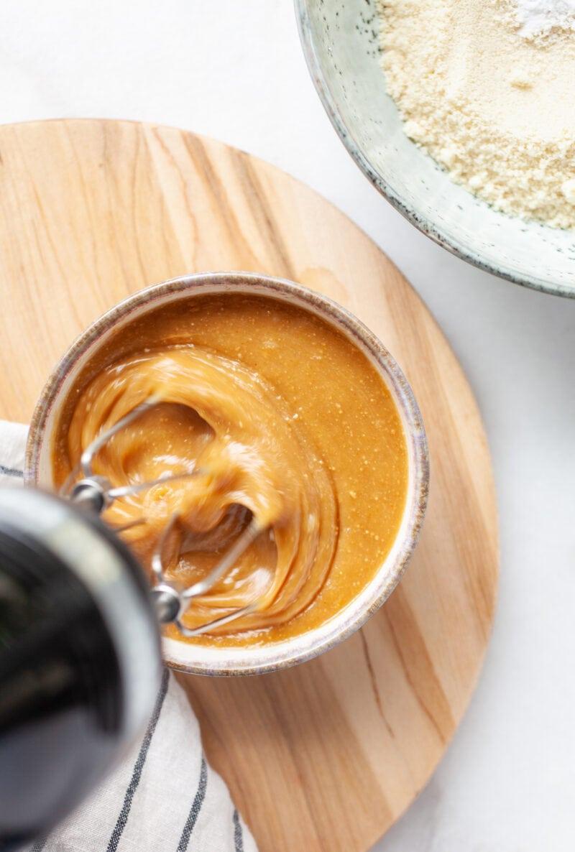 blending peanut butter mixture for almond flour peanut butter cookies with a hand blender