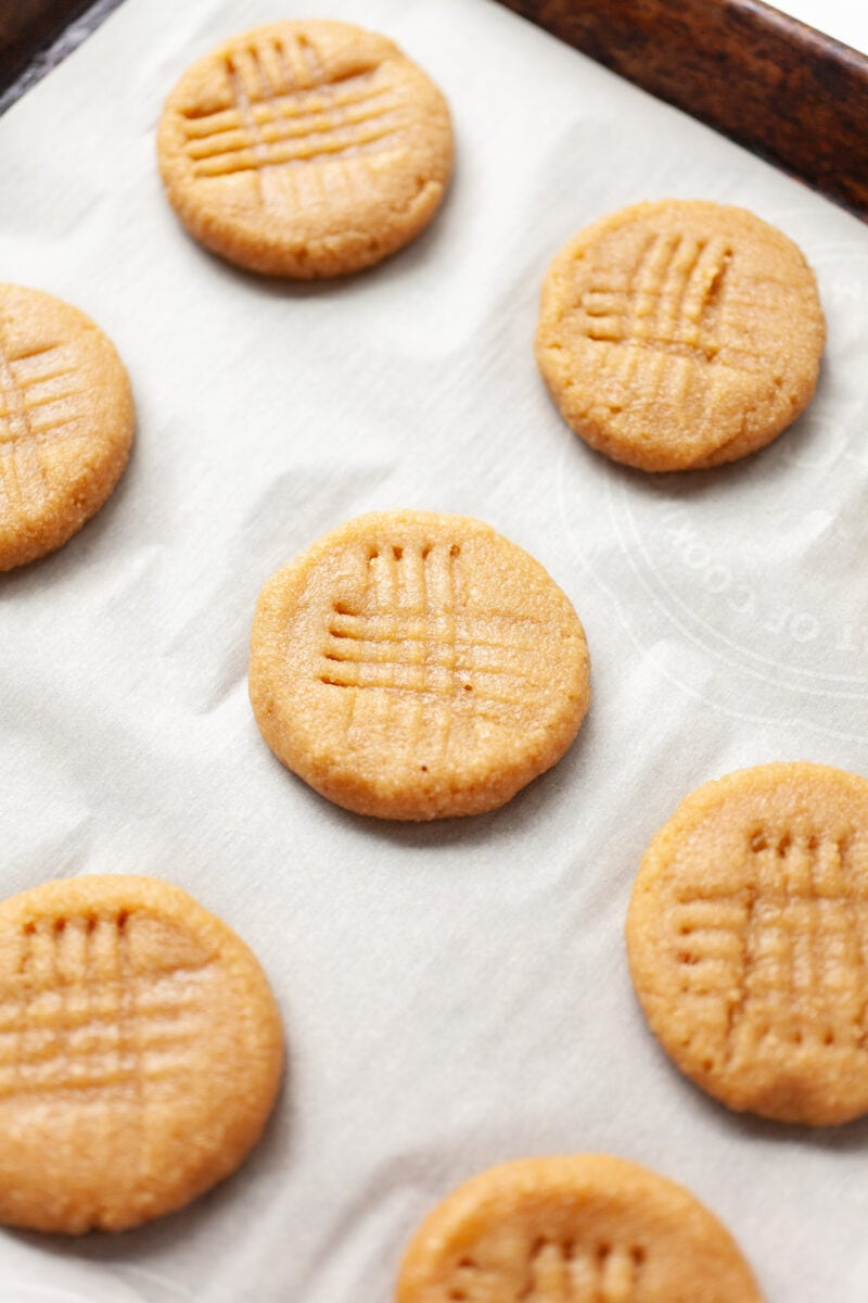 raw almond flour peanut butter cookies on a baking tray before cooking