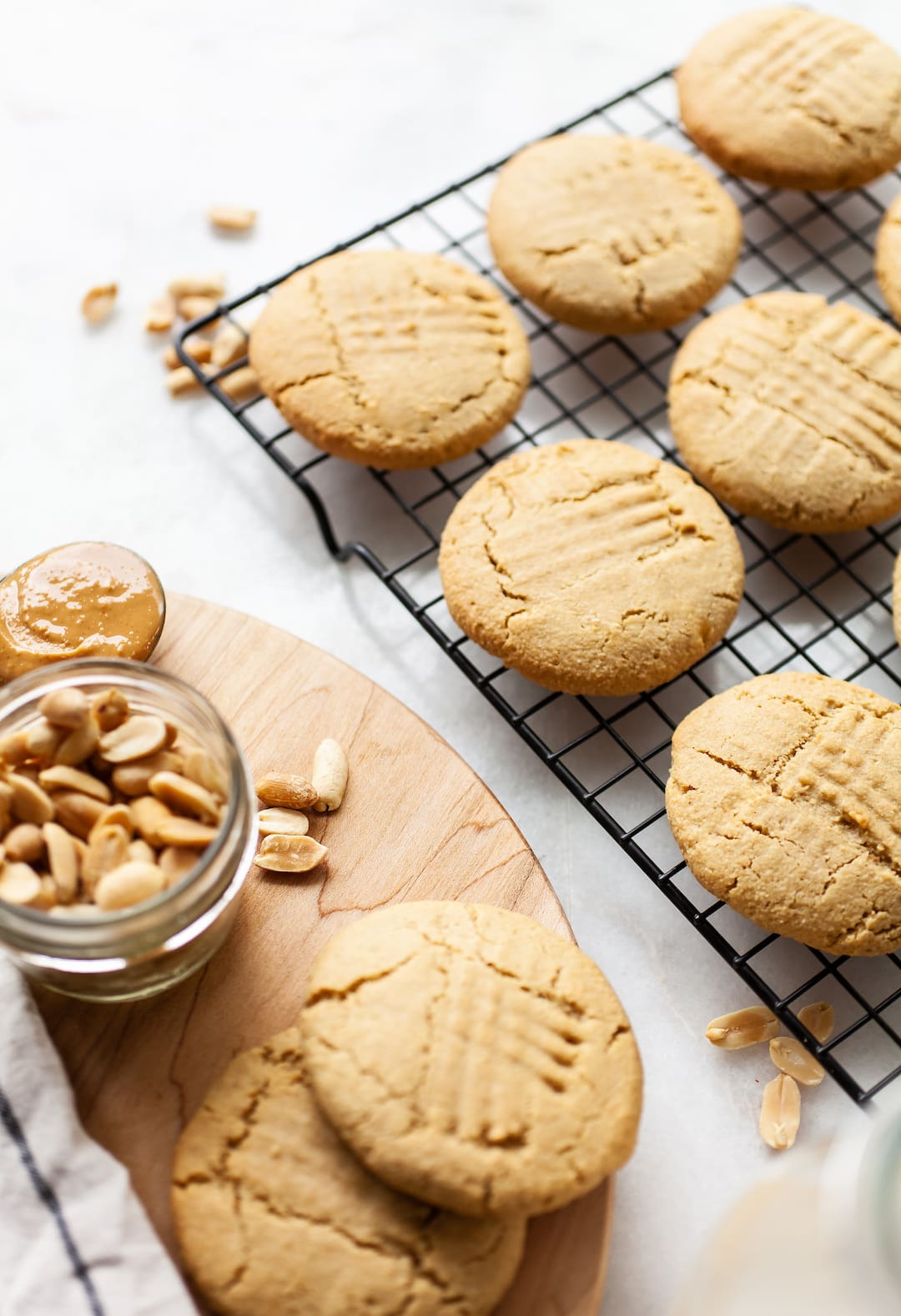 Close up of almond flour peanut butter cookies on a black cooling rack