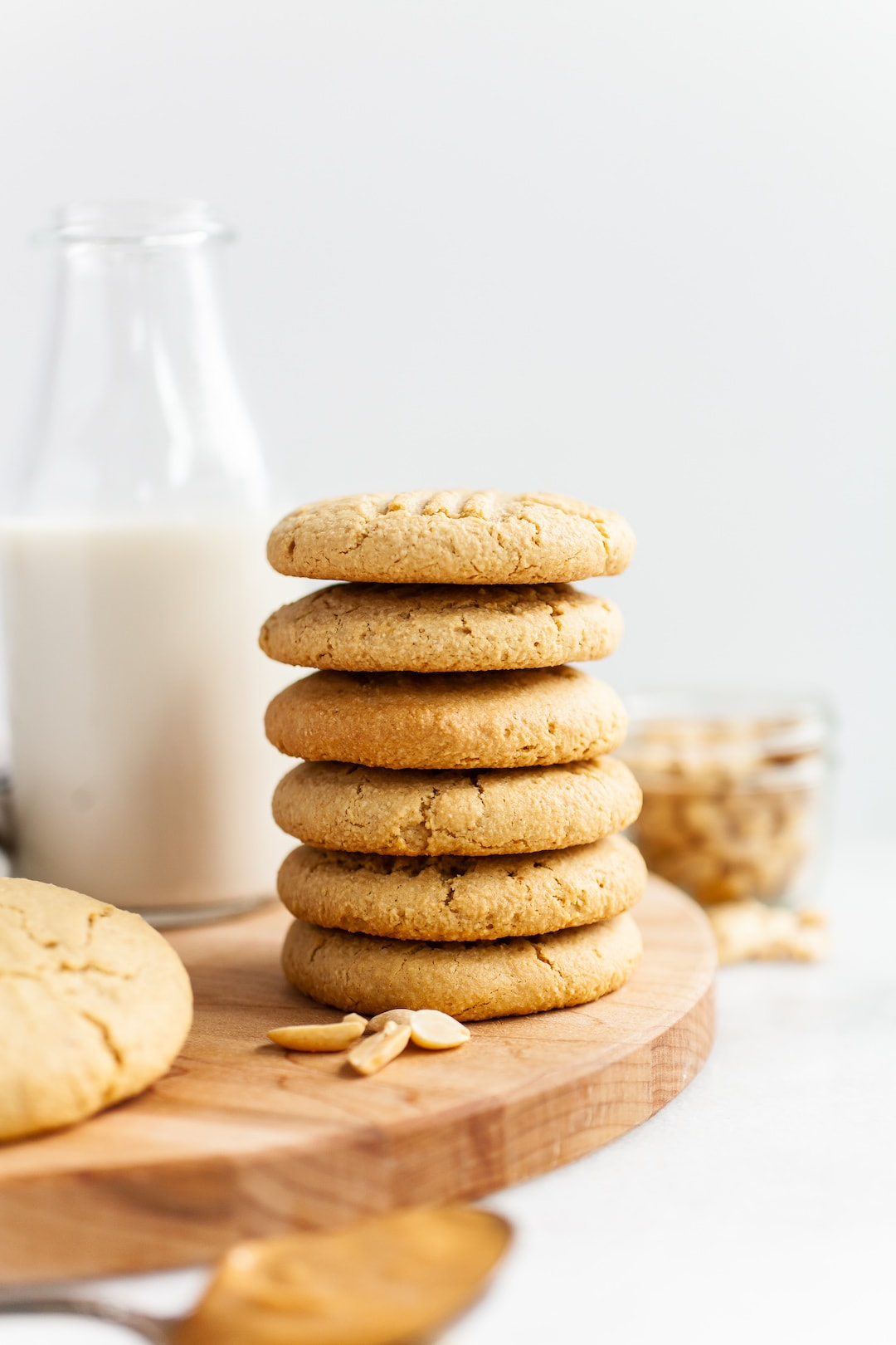Close up of a stack of six almond flour peanut butter cookies on a wood tray