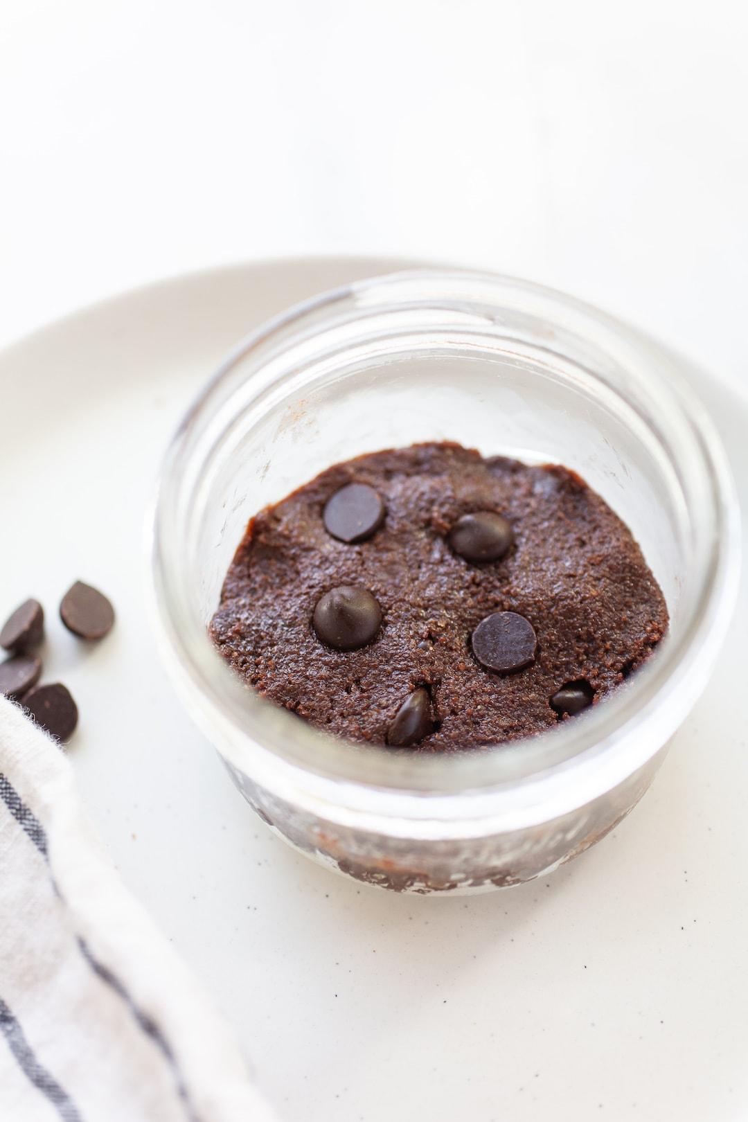 unbaked vegan mug brownie batter in a jar