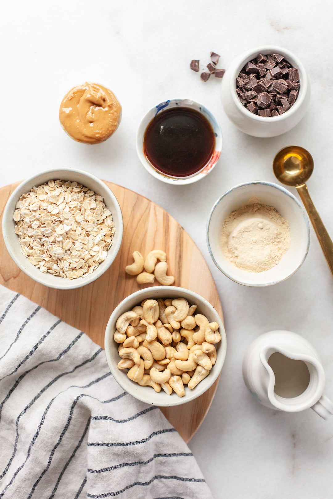 overhead view of ingredients for protein cookie dough in bowls