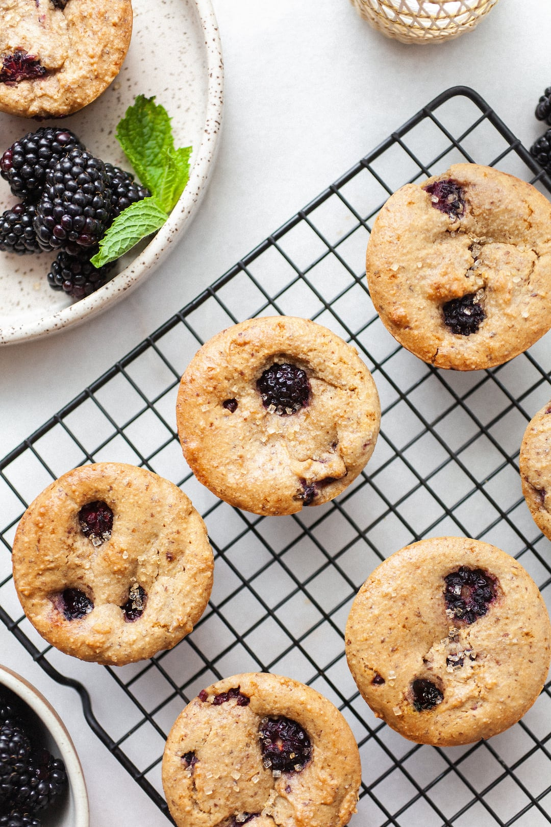 Cooling rack topped with Vegan Blackberry Muffins