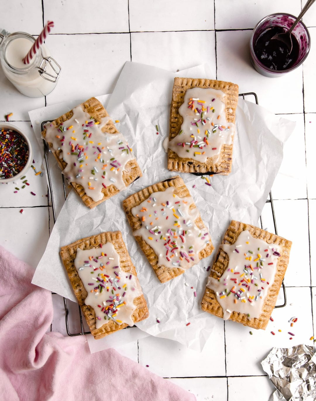 overhead view of vegan gluten free pop tarts topped with vanilla icing and sprinkles