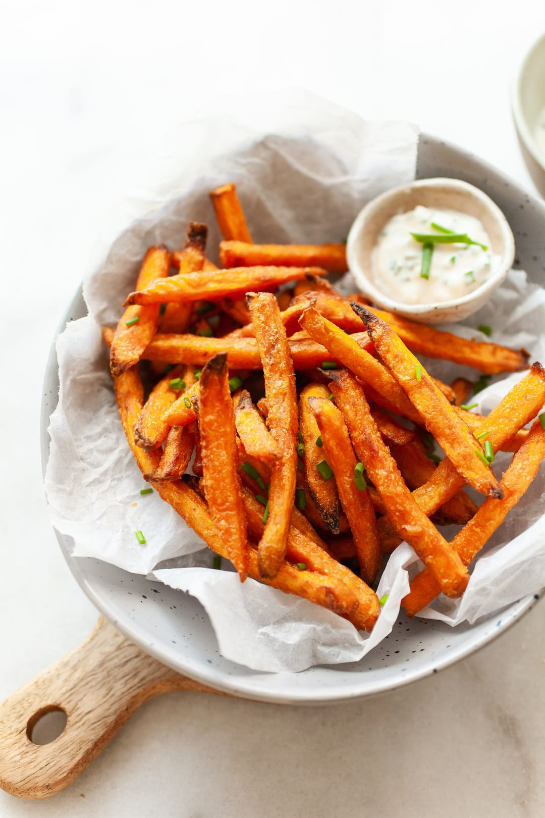 cooked from frozen sweet potato fries in a bowl with aioli dip on the side