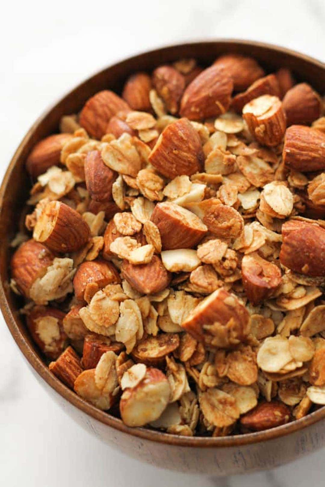 image of air fryer granola in a bowl with almonds