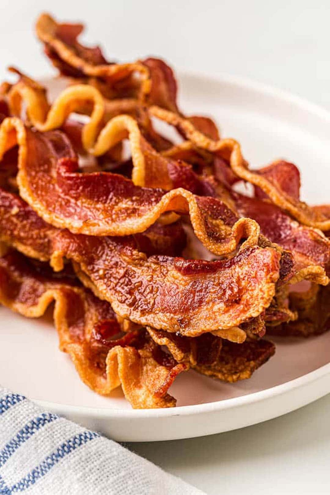 image of air fryer bacon strips on a white plate